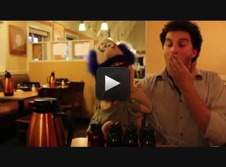 Joel holding a puppet in an IHOP